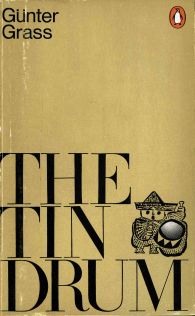 Penguin paperback cover of Gunter Grass novel The Tin Drum with large Bodoni type and drawing of boy and drum by Gunter Grass